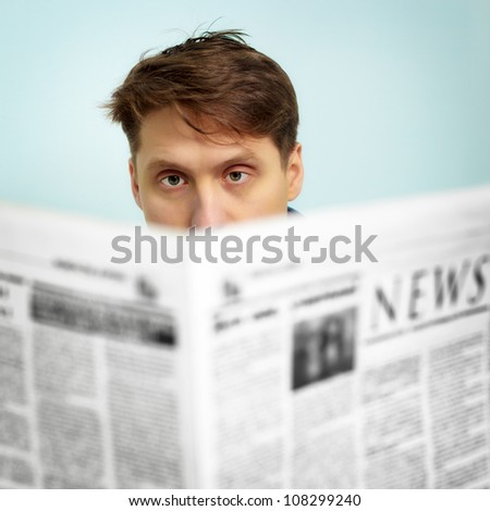 A man reads the news in the newspaper - stock photo