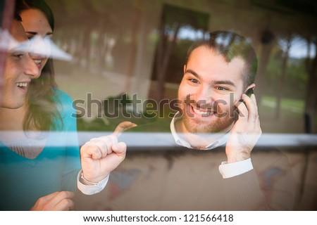 A man receive some happy news during a phone call - stock photo
