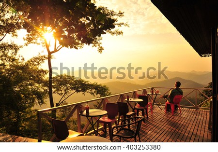 A Man Relax at The Cafe on The Hill - stock photo