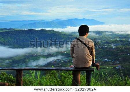 A Man Relax on The Top of The Hill - stock photo