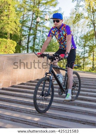 A man rides a Bicycle on the steps
