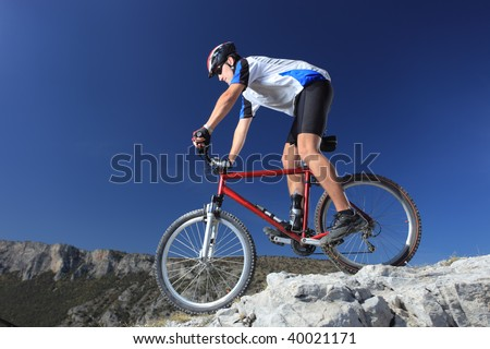 A man riding a mountain bike downhill style