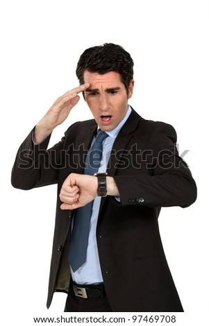 A man running late. - stock photo