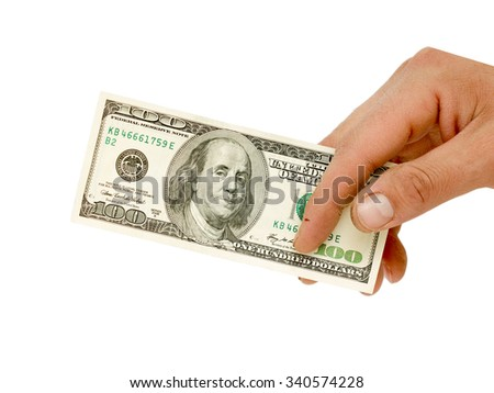 A man's hand holding a one hundred dollar bill.  - stock photo