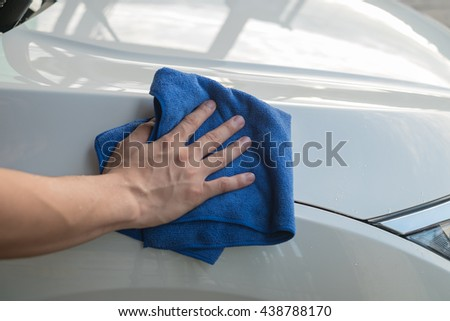 hand microfiber cloth cleaning leather seatauto stock photo 520045975 shutterstock. Black Bedroom Furniture Sets. Home Design Ideas