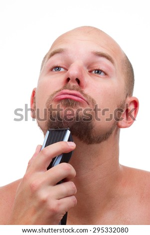 a man shaving electric machine