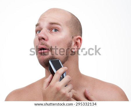 a man shaving electric machine - stock photo