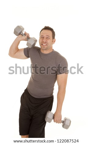 a man showing his wimpy side and not wanting to work out. - stock photo