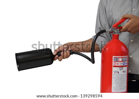 A man showing how to use fire extinguisher isolated over white background - stock photo