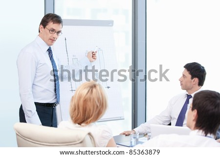A man shows a presentation at the office - stock photo