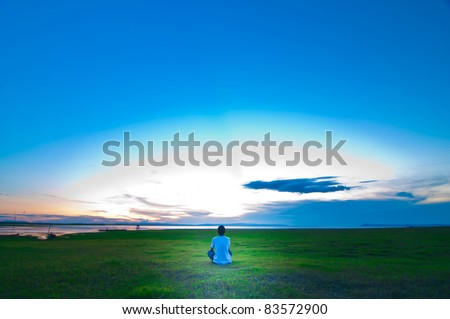 a man sitting for sunset
