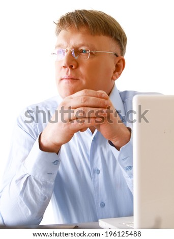 A man sitting in front of a laptop - stock photo