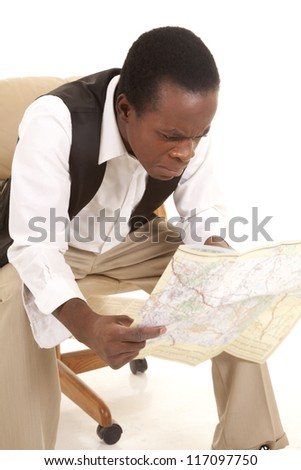 A man sitting in his chair with a upset confused expression while looking at all the roads. - stock photo