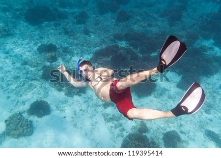 A man snorkeling in  Andaman Sea, Thailand - stock photo