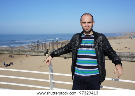 A man standing by the beach in Holland