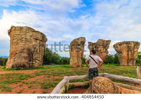 A man standing in front of beautiful nature during sunrise time at Stonehenge of Thailand , MOR HIN KHAOW CHAIYAPHUM