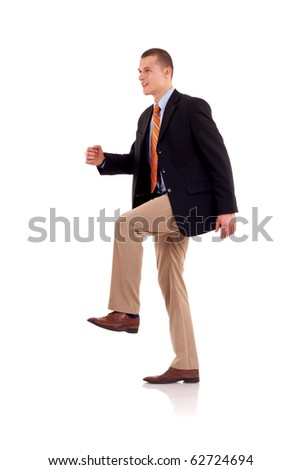 A man stepping up against a white background - stock photo