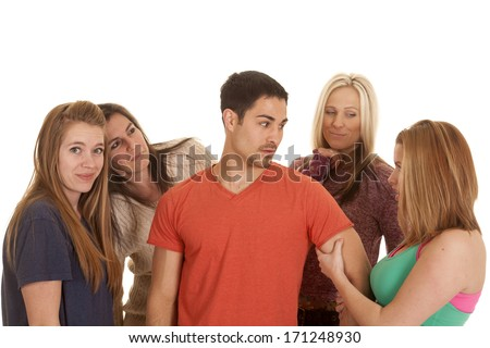 A man surrounded by business women and women dressed in fitness clothes. - stock photo