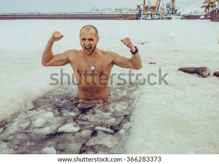 A man swims in the winter
