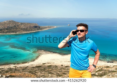 A man talking on the phone on the sea - stock photo