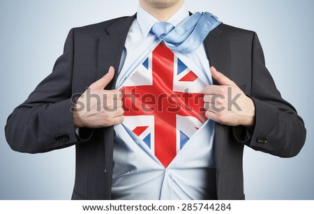 A man tearing the shirt. Great Britain flag on the chest. - stock photo