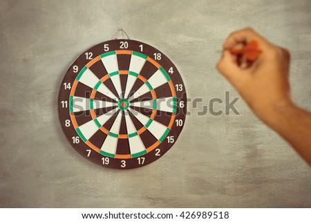 A man throw a Plastic tip Dart ,Target aim symbol of goal , business concept - stock photo
