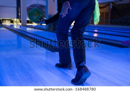 a man throwing a ball playing bowling - stock photo