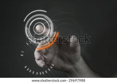 A man touching a futuristic button. - stock photo
