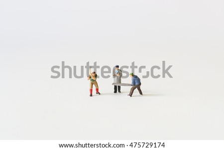 A man try to stop fighting between two workers figures with copyspace