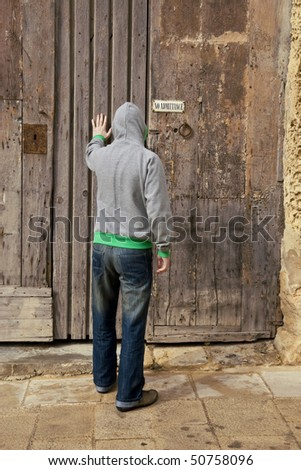 A man trying to gain entry