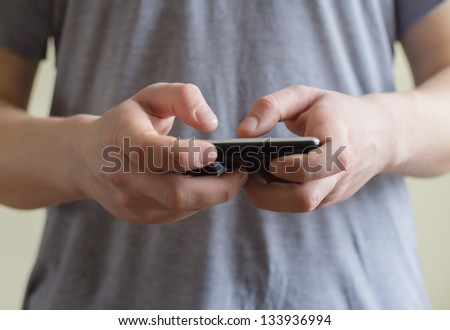 A man using a mobile phone - stock photo
