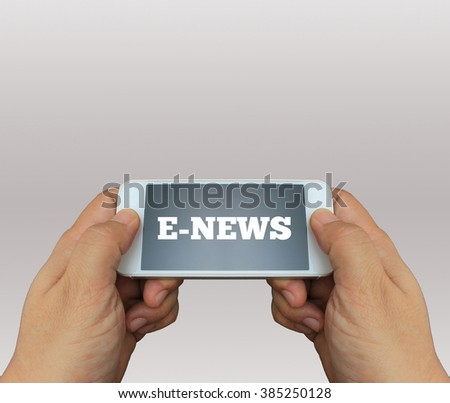 a man using hand holding the smartphone with text E-News on display - stock photo
