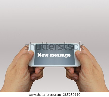 a man using hand holding the smartphone with text New meaasge on display - stock photo