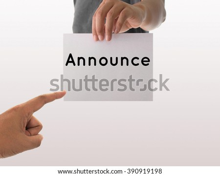 a man using hand holding the white paper with text announce