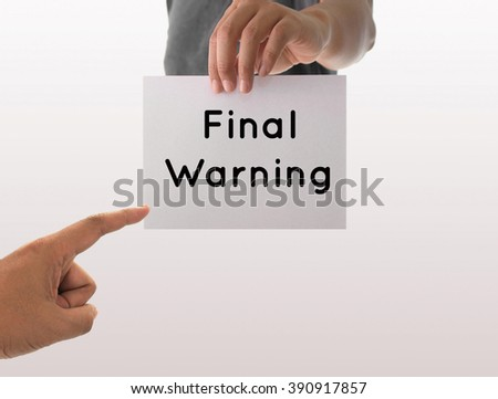 a man using hand holding the white paper with text final warning