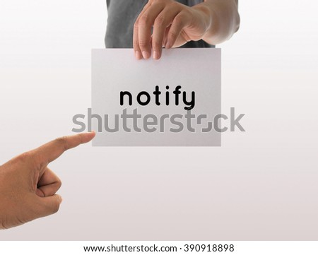 a man using hand holding the white paper with text notify