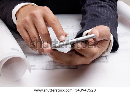 A man using mobile smart phone. - stock photo