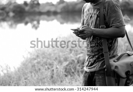 a man using mobile smart phone,Black and White effect. - stock photo