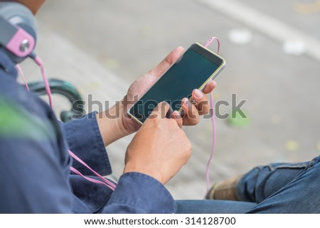 A man using mobile smart phone.selective focus - stock photo