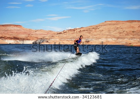 A man wakeboarding at Lake Powell. - stock photo