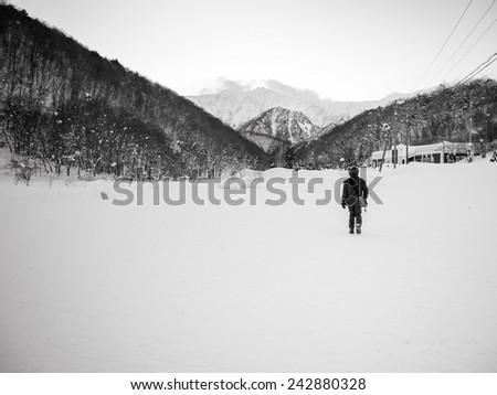 A man walking on snow, Kashimayari, Nagano, Japan. - stock photo