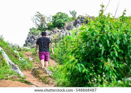 A man walking to the hill