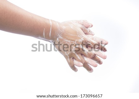 A man washes he hands with soap. Isolated on white