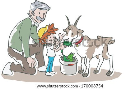 A man watching his child feed a goat. - stock photo