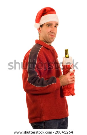 A man wearing a santa hat, holding a bottle of wine, isolated against a white background - stock photo
