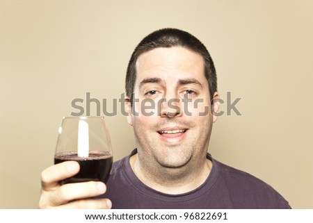 A man who has had a few drinks - stock photo