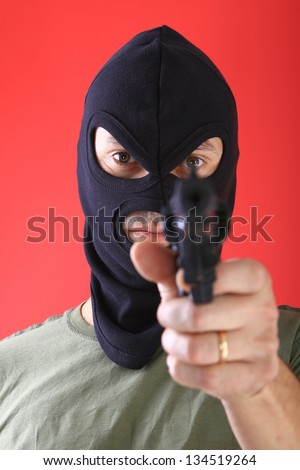 A man with a black mask, burglar