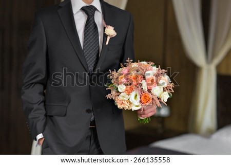 a man with a bouquet  - stock photo