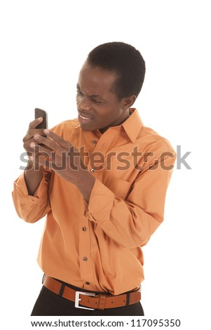 A man with a confused expression  looking at his phone. - stock photo
