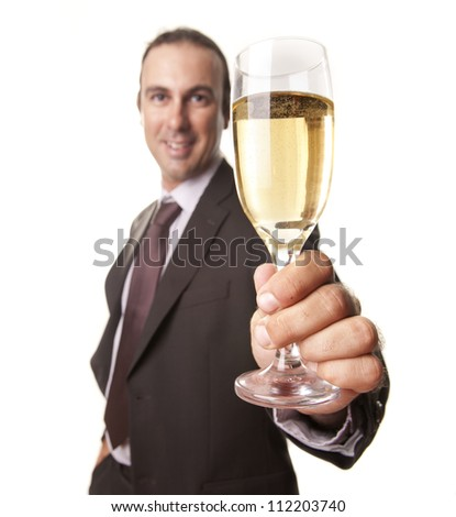 a man with a glass of champagne to celebrate an event - stock photo